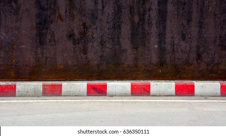concrete road - sidewalk and curb red-white