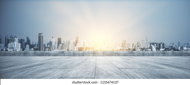 Concrete rooftop with beautiful sunset city view background