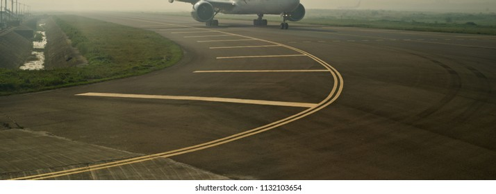 A concrete runway of an airport in the morning isolated unique blurry photo
