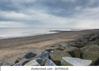 Concrete sea defences and wave breakers on Withernsea Beach, East Yorkshire, UK, environmental issues