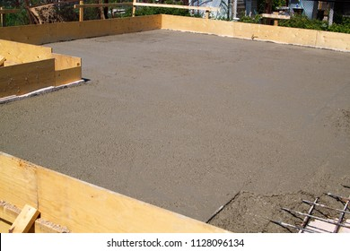 concrete slab of foundation with wooden formwork