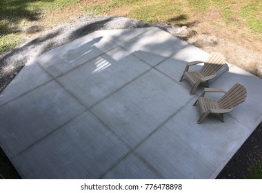 concrete slab with plastic chairs