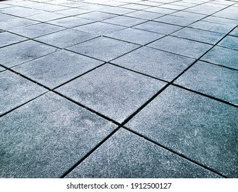 Concrete slabs in perspective. Geometric photo from the central square of the city.