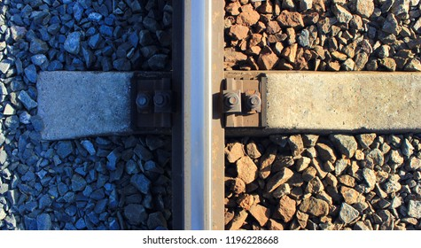 Concrete Sleeper of Train Railroad Track with Gravel Stones and Metal Rail, Close Up Top View. Railway Track Detail of Industrial Iron Sleeper,Transit Vintage Old Rail Road System Wallpaper