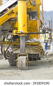 Concrete slipform paver being used to install a curb and gutter on a new street and road project