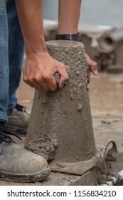 Concrete slump test before pouring a foundation in construction site