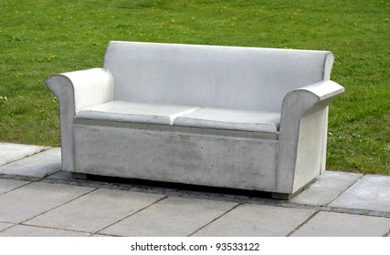 Concrete sofa in park, symbol for uncomfortability.