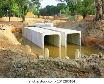 Concrete square pipe  for water  in garden.