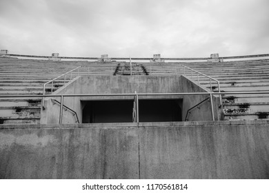 Concrete stairs with iron rails for the grandstand in the stadium. Black and white.