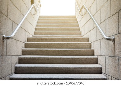 Concrete stairs with stainless handrail with sun rise, business conception success and growth in work career, way to successful business.