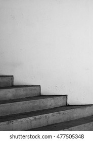 concrete steps with white wall