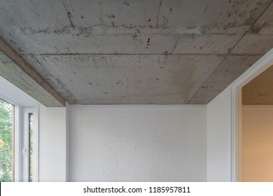 Concrete style in the apartment. Concrete ceiling and lighting in a modern apartment.