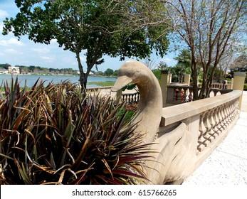 A concrete swan decorates the railing of Hollis Park in Lakeland, Florida