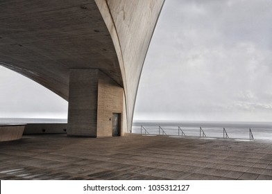 Concrete terrace  with misterious industrial Atlantic Ocean view in Santa Cruz of Tenerife. Minimalistic architecture. Cold colors