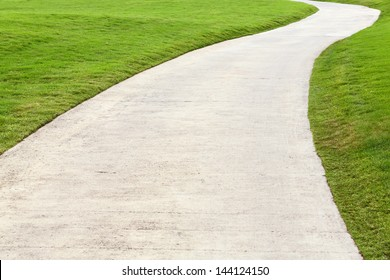 Concrete walking way in golf course