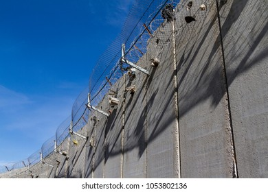 A concrete wall built by Israel to stop West Bank Palestinians from commuting in East Jerusalem.