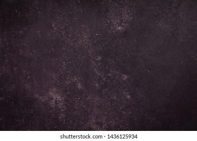 concrete wall of dark purple color, cement texture background for design