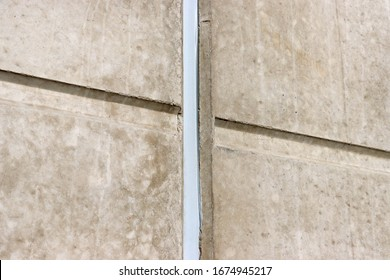 Concrete Wall. Concrete  Expansion  Joints. Polyurethane putty sealant