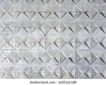 Concrete wall with geometric pattern backdrop