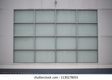 Concrete wall with glass.
