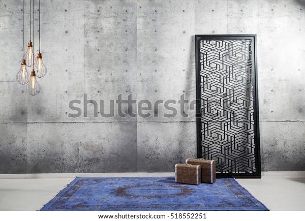 concrete wall interior decor and blue rug, modern lamp