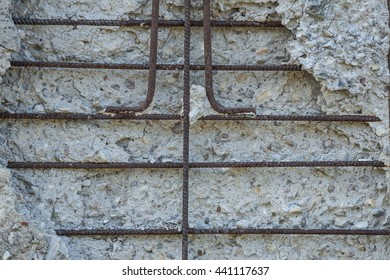 concrete wall with rusty reinforcement rods background