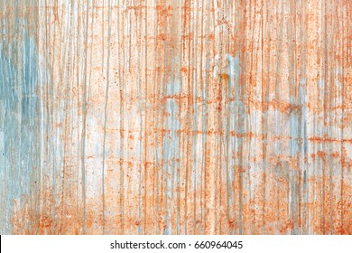 Concrete wall with salmon-colored paint streaks