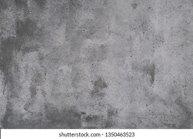 Concrete wall with stains and cracks