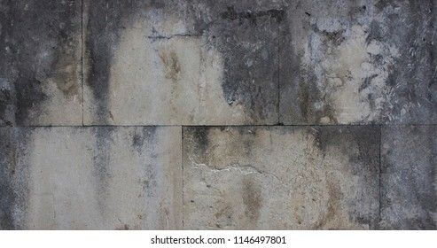 Concrete wall. Texture of marble. Runs of old. Division into rectangles.Natural stone textures.Concrete light gray slabs. The modern tile wall background.
