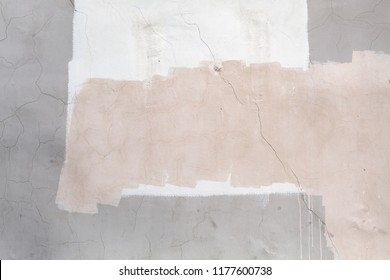 Concrete wall with white and pink paint layers, close-up background texture