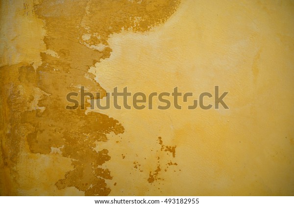 Concrete wall yellow color, texture background