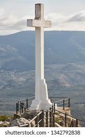 Concrete white cross viewpoint in Jaen. Santa Catalina castle. Spain