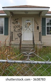 A condemned home in the 9th Ward of New Orleans, Louisiana, damaged in Hurricane Katrina. The writing indicates a dead dog was found in the home and needed to be picked up.