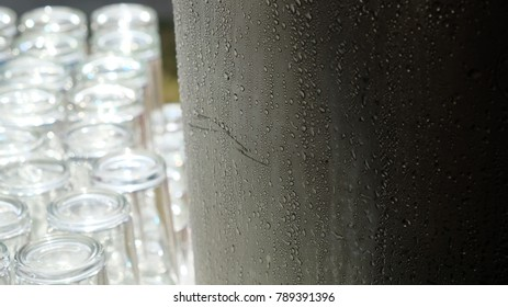 Condensation occured on the surface of Stainless Steel uce cobrainer with bokeh background of glasses. - Shutterstock ID 789391396