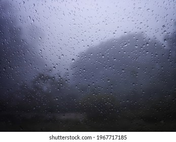 Condensation on the clear glass window. Water drops. Rain. Abstract background texture, india.