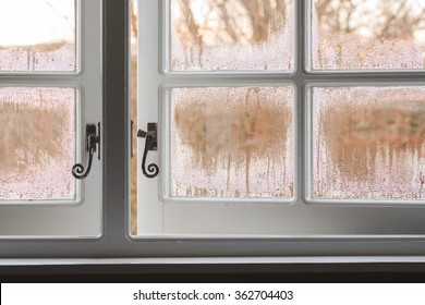 Condensation on inside of traditional single glazed wooden windows