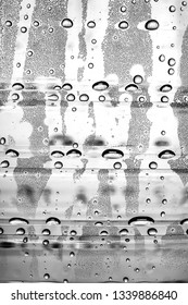 condensation water droplets on a plastic surface