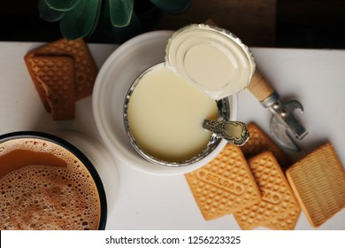 condensed milk with cookies and coffee