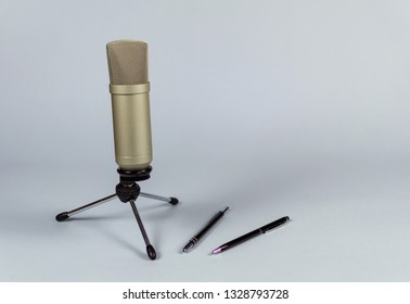 Condenser microphone with holder on light background