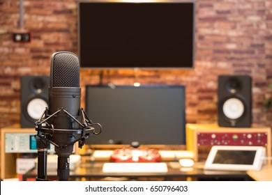 condenser microphone on digital recording studio background
