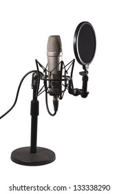 A condenser microphone with shock mount and pop shield in a desk stand isolated over white background, with clipping path