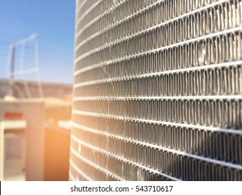Condenser unit used in central air conditioning systems - heat exchanger-heat micro channel section to cool down and condensate incoming refrigerant vapor into liquid. background texture. technology.