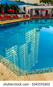 Condo Tower Reflected in Blue Pool