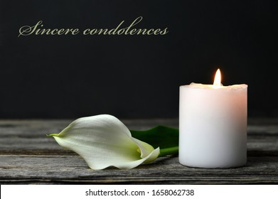 Condolence card. Burning candle and white calla lily