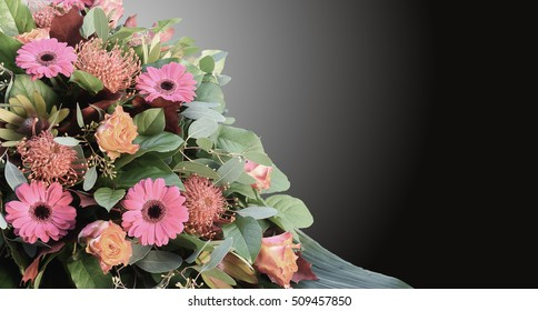 Condolence card with flowers arrangement and dark background.