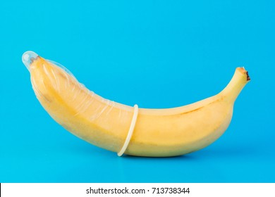 Naked young girl masturbating with a banana