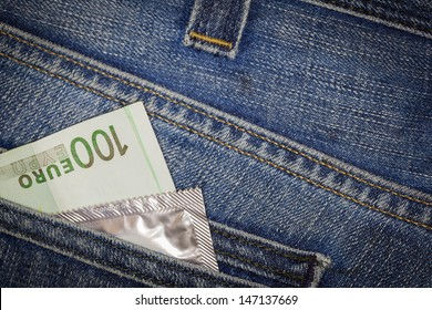 Condom and euro in blue jeans back pocket