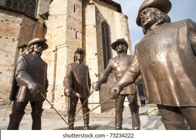 CONDOM, FRANCE - SEPTEMBER 4: Statue of D'Artagnan and the three musketeers. The sculptor is  Zurab Tsereteli. This sculpture was inaugurated on September 4 2010, in Gascony, Condom, France.