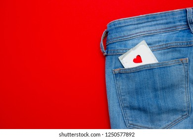 a condom in a jeans pocket. safe sex