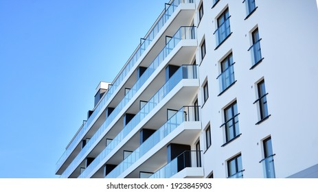 Condominium and apartment building with  symmetrical modern architecture in the city downtown.